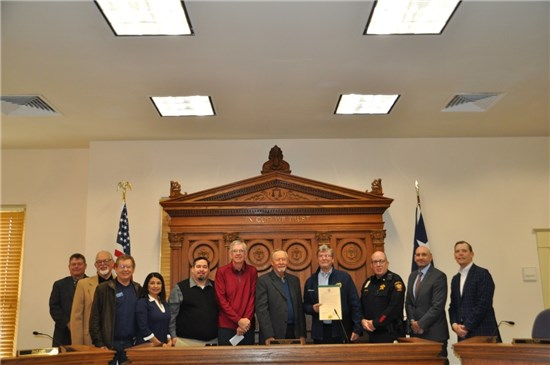 Left to right, Precinct 2 Commissioner Mark Jones, Lions Club members Frank Curtis, 50thAnniversary Committee member; Patrick Cox, Past President; Precinct 1 Commissioner Debbie Gonzales Ingalsbe, Bobby Burns, 3rdVice President; Vic Forsyth, Past President; Ron Steel, 1stVice President; Richard Newsum, President, Ronnie Strain, Past Lion Tamer, Precinct 3 Commissioner Lon Shell, and Precinct 4 Commissioner Walt Smith.