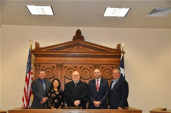 Retired County Judge Bert Cobb, M.D., center, stands on the dais prior to taking medical leave with Commissioners Debbie Gonzales Ingalsbe, Mark Jones, Lon Shell and Ray Whisenant in October 2017.